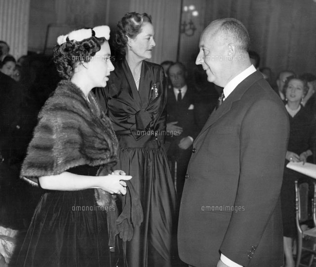 Christian Dior with Princess Margaret at Blenheim Palace, home of the Duke and Duchess of Marlborough, for the preview of Dior's 1954 Winter collection. Novemeber 1954