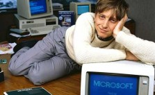1985, Bellevue, Washington, USA --- Bill Gates, CEO of Microsoft, reclines on his desk in his office soon after the release of Windows 1.0. --- Image by   Deborah Feingold/CORBIS 1 Adults Americans Bellevue Bill Gates Business and commerce Businesspeople CEO Clothing Company executive Computer Computer hardware Cream Desk Eye contact Full-length portraits Full-length studio portraits Furniture Gray Hands on head Indoors King County Males Men Microsoft Corporation North America Office Pacific Northwest Pants People Personal computer Portraits Prominent persons Reclining Room Software manufacturer Studio portraits Sweater USA Washington State White Whites Window
