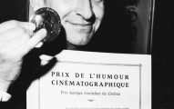 Louis de Funes on December 20, 1967, with his diploma and his medal of the Prix Courteline, awarded for cinematographi humour, which he received for his role in the movie LES GRANDES VACANCES.  Le 20 dйcembre 1967, Louis de Funиs avec son diplфme et sa mйdaille du Prix Courteline de l'humour cinйmatographique pour son interprйtation dans le film LES GRANDES VACANCES.